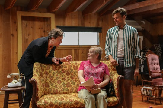 "Neil Brookshire, Penny Slusher and Will Skrip rehearse for the Peninsula Players  production of  ""A Murder is Announced,"" a play adapted from the Agatha Christie novel."