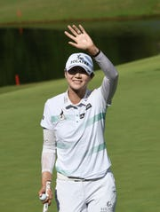 Sung Hyun Park waves to fans after sinking her final putt to win the LPGA Walmart NW Arkansas Championship on Sunday in Rogers, Ark.