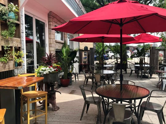 Stella's patio is right on Fourth Street in De Pere but feels tucked away thanks to big planters, climbing vines and the canopy of trees.