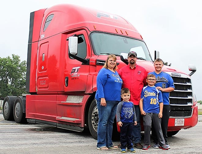 Ross Christensen of Oconto, his wife Courtney and their three children Cason, Conner and Logan are pictured next to Ross's semi-tractor.