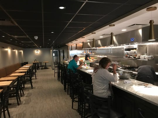 The High Cotton Club, a new fine dining restaurant at 121 N. Adams St., offers diners a clear view of the kitchen. Skaliwags Chef Chris Wiltfang opened the restaurant in early July.
