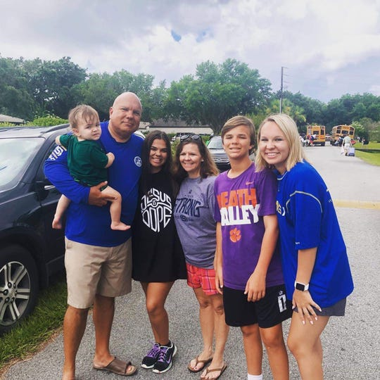 Brian Smith with (left to right) son Riggins, daughter Britney, wife April, son Bret and daughter Bri.