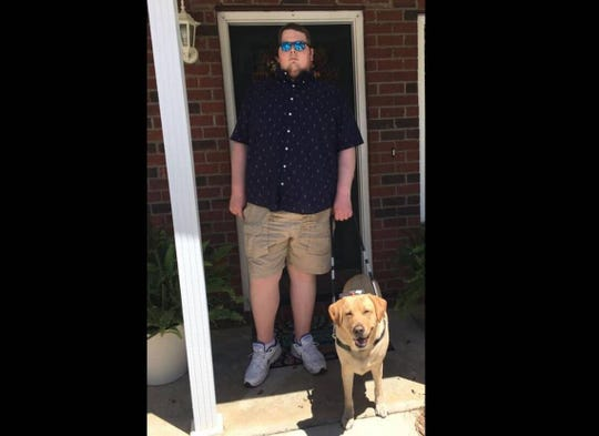 Taylor Burch and his service dog.