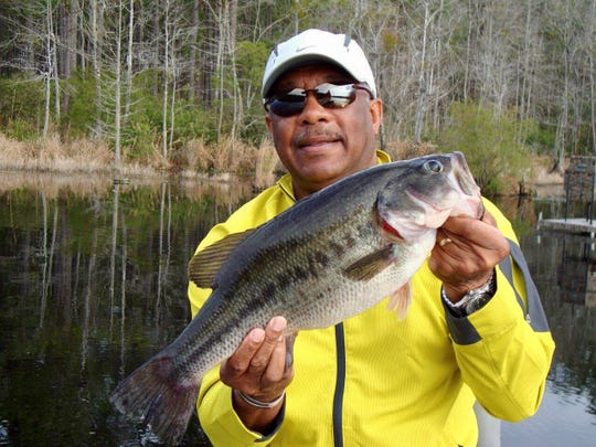 Woody McCorvey shows off a hefty largemouth bass.