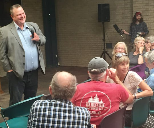 Sen. Jon Tester takes a question Tuesday during a town hall at Helena College University of Montana.