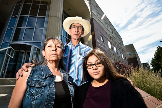 Cletus Cole, mother, Earline Bearcrane Cole, father, and Precious Bearcrane, daughter, to Steven Bearcrane Cole, who was shot to death in 2005, stand on the steps of the Paul G. Hatfield Federal Courthouse after a hearing in the 10-year-old civil lawsuit questioning the FBI investigation into Bearcrane's death.
