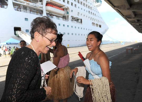 The Sea Princess cruise ship sailed into Guam's harbor on April 5, 2012, bringing in more than 2,700 passengers and crew members to the island for a one-day visit. At the port dockside, cultural dancers from the Irensian Taotao Tano' greeted the passengers with shell leis and smiles.