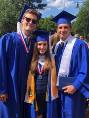 From left, Zach Weatherell, Emily Saffle and Carson Hall at their graduation from Sacred Heart High School.