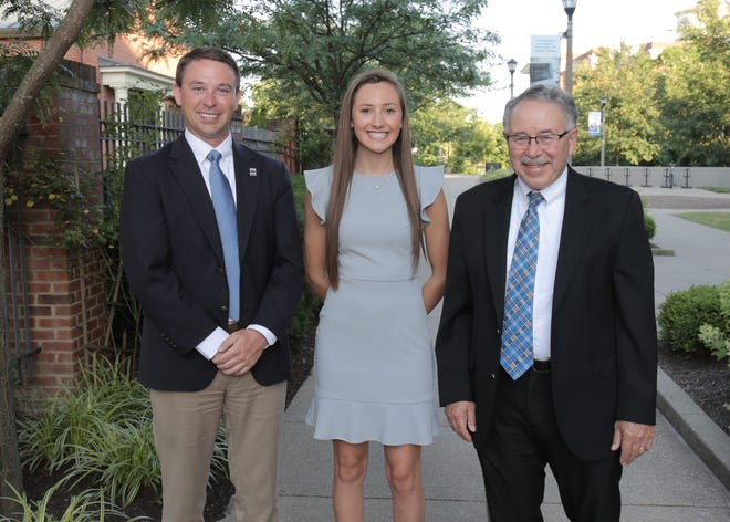 Sydney Simpson (center) is greeted byKyle Kelly, Director of Local Affairs for Kentucky Farm Bureau(left) and Dr. Larry Grabau, UK College of Agriculture, Food and Environment, Associate Dean for Instruction (right), during the 2019 Institute for Future Agricultural Leaders (IFAL) at the University of Kentucky.