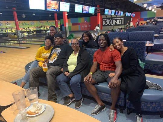 Left to right: Asia (Trayvon's niece), Tamara (family friend), Terrence (older brother), Jackie (mom), Debra (aunt), Trayvon and La Keila (Trayvon's wife).