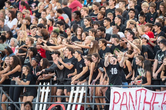 FILE – The North Central student section packed the stands for a 2018 football game. Some area schools are making admission free for students.