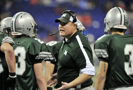 FILE – Monrovia coach Kevin Hutchins talks to his players during the 2015 Class 2A state title game. Hutchins joined the Center Grove staff this week.
