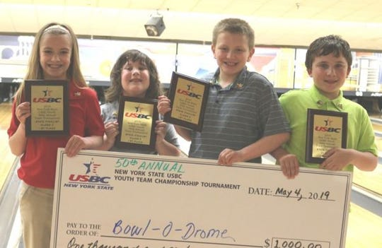 "The Ithaca Youth Bowling Class ""C"" state championship team, from left): Ezra Sybert, Zoe Palermo, Oscar Sybert and Zach Palermo,"