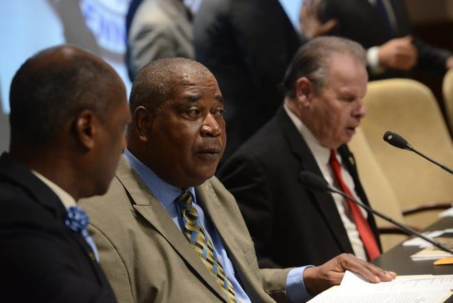 Harvey Buchanan, center, represents district 4 on the Jackson City Council.