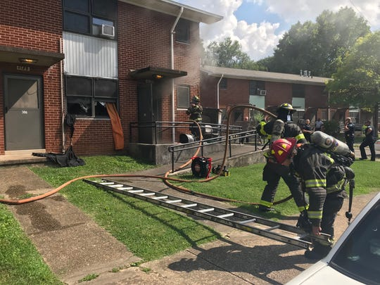 Two police officers and a smoke inhalation victim went to the hospital after a fire at Austin Homes Apartments in Knoxville on Monday, July 1, 2019.