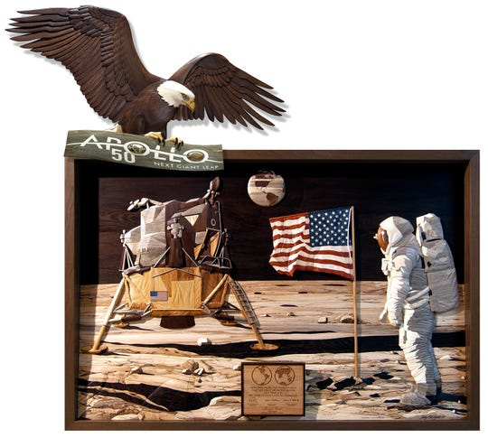Judy Gale Roberts' commemorative Intarsia woodwork for the 50th anniversary of Apollo 11 spotlights the historic moment of U.S. history of the Moon landing.