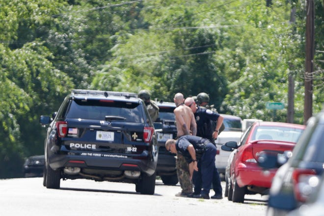 Lafayette police work the scene of a barricaded suspect on the 1400 block of Washington st., Tuesday, July 2, 2019 in Lafayette. Police took into  domestic battery suspect Robert Ray McGill after he surrendered peacefully.