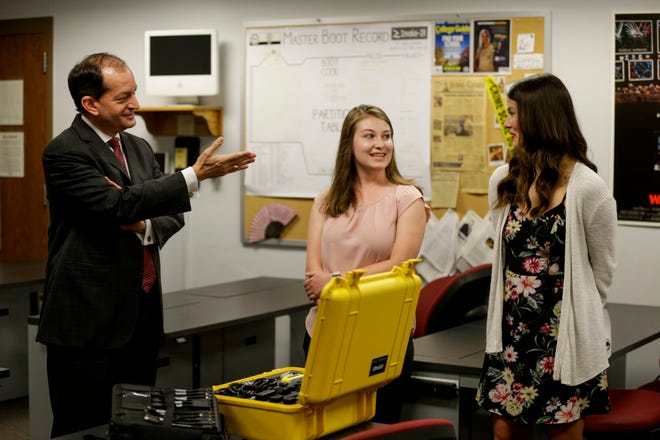 U.S. Secretary of Labor Alexander Acosta speaks with digital forensics students, Kelsey Billups and Sienna Bates, during a tour of the digital forensics lab, Tuesday, July 2, 2019 at Purdue University in West Lafayette. Secretary Acosta visited Purdue to award a $12 million grant to the Purdue Polytechnic Institute for its cyber security program.