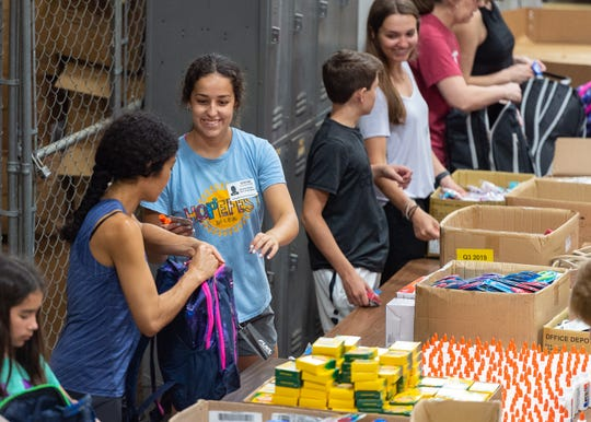 Volunteers work at the Lafayette Parish School System warehouse, stuffing backpacks with school supplies to be donated to thousands of students at eight Lafayette Parish schools as part of the Love Our Schools initiative. Through the program, nearly 5,000 students will receive backpacks filled with school supplies.  Tuesday, July 2, 2019.