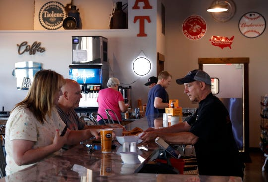 Mick Boyer, and his wife Jamy Boyer get their food as they have breakfast Tuesday morning, July 2, 2019, at Weidner's Corner near Baltimore.
