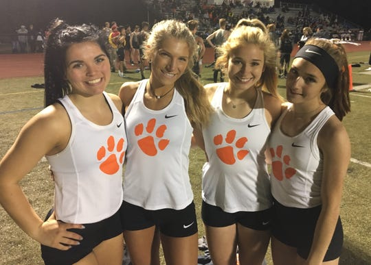 Brighton's 800-meter relay team consisted of (from left) Felesity Norris, Bryce Calka, Kennedy Smith and Morgan Waggoner.