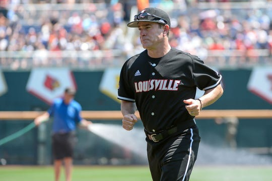 Louisville Cardinals head coach Dan McDonnell runs to the dugout before the game against the Vanderbilt Commodores in the 2019 College World Series at TD Ameritrade Park in Omaha, Nebraska, on June 16, 2019.