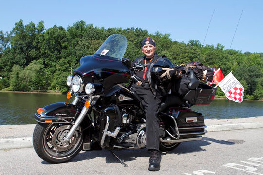 Oldham County veteran Bruce Heilman sitting on his Harley-Davidson motorcycle.