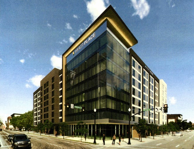A developer has submitted a proposal to build an eight-story hotel at the corner of West Market and Second Street in downtown Louisville. This artist's rendering shows the proposed Hyatt hotels that would replace the two buildings where Action Loan and two restaurants now are located.