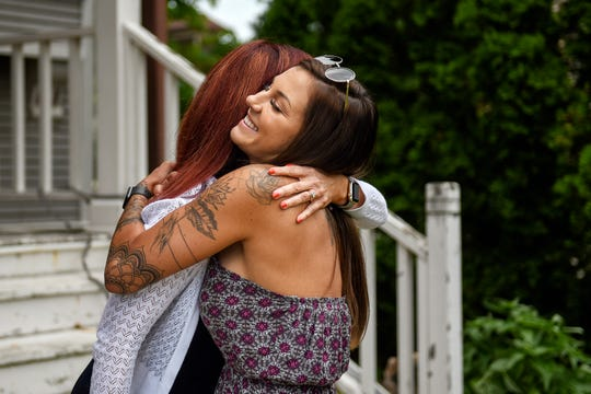 Ingham County Circuit Court Judge Joyce Draganchuk, left, hugs Brittni Warren at RISE Recovery Community, a sober living facility that Brittni's husband Corey founded, on Friday, June 27, 2019, in Lansing. Corey, a recovering heroin addict, met Judge Draganchuk as she was sentencing him for a crime when he was 18. Judge Draganchuk recently presided over the couples wedding.