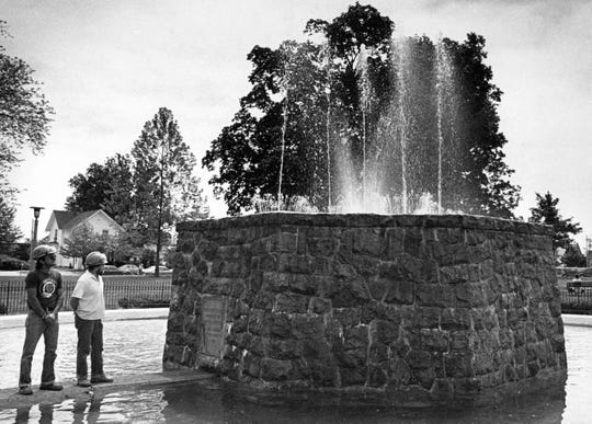 This photos from May 1985 shows city workers checking the Reutter Park fountain after the city turned it on for the season.