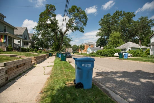 Garbage carts, provided by Capital Area Recycling and Trash, seen on Lansing's east side Tuesday, July 2, 2019.