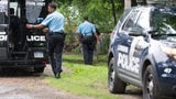 Police search yard - human remains found