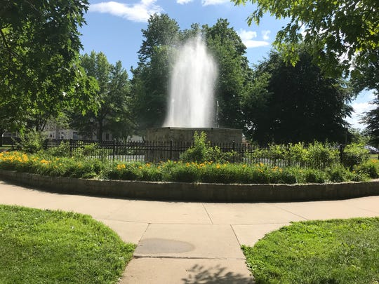 The fountain in downtown Lansing's Reutter Park dates back to 1929. City officials were able to turn the fountain back on this year after crews made some repairs.