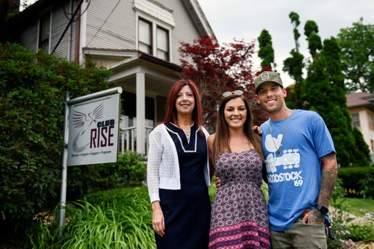 Ingham County Circuit Court Judge Joyce Draganchuk left,  recently presided over Corey, right, and Brittni Warren's wedding. Corey, a recovering heroin addict, met Judge Draganchuk as she was sentencing him for a crime when he was 18. The three are photographed Friday, June 27, 2019, at RISE Recovery Community, a sober living facility that Corey founded.