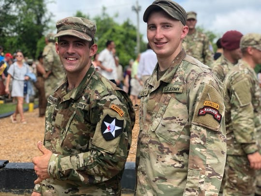 Nicholas Whitney, left, and Josh Leneau, right, at Ranger School Graduation on June 16 in Fort Benning, Georgia.