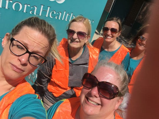 Aurora Medical Center staff in Two Rivers recently participated in a highway cleanup. Pictured, from left: Pam Waise, Cathie Kocourek, Tara Ebert and Hailey Wolf.