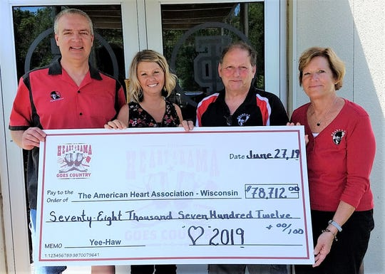 Heart-A-Rama presents its check to the American Heart Association. Pictured, from left: Jim Pautz, producer; Kelli VanderWielen, AHA development director; Tom Bartelme, general co-chairman; and Karen Schweitzer-Olson, general co-chairwoman.