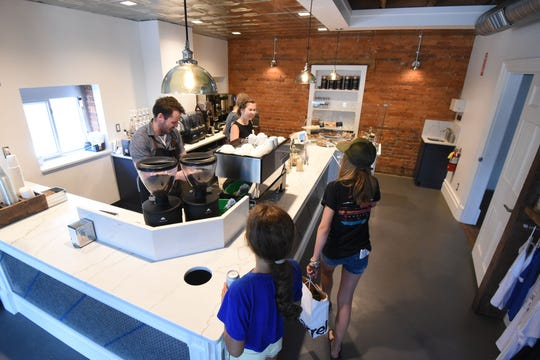 Nickel & Bean in Lexington was buzzing with business Tuesday morning.