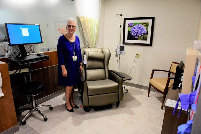 One of the hospital's new private infusion areas is shown off by Patti Kastelic, RN, director of cancer care and imaging.