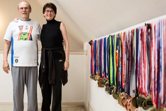 Frank and Kay DiBianca stand near dozens of medals they have been awarded from different competitions including the National Senior Games on July 1, 2019. Every two years the Senior Games, formerly known as National Senior Olympics, give people over 50 a chance to compete in Olympic style events. Kay, 73, entered the games in 2013 while Frank, 79, began competing in the games in 2015.