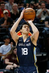 Memphis Grizzlies' Yuta Watanabe (18) shoots against the Utah Jazz during the first half of an NBA summer league game Monday, July 1, 2019, in Salt Lake City.