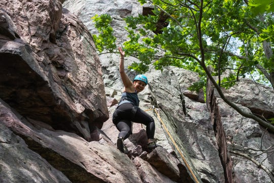 Leanna Vannarom climbs a route on the West Bluff at Devil's Lake State Park during a rock climbing trip with First Descents on June 22, 2019.