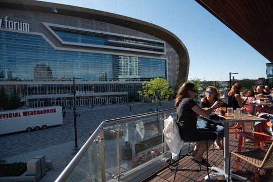Patrons on the second-floor patio at Punch Bowl Social downtown have a view of Fiserv Forum.