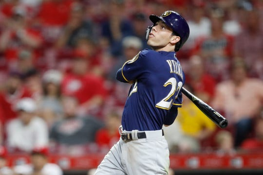 Christian Yelich watches his two-run home run in the ninth inning, his 30th of the season.