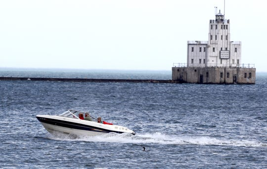 A powerboat enjoyed an outing last fall on Lake Michigan in the Milwaukee Harbor