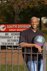 Milwaukee Bucks head coach Terry Porter stands outside of his alma mater at South Division High School in Milwaukee, WI. Oct. 22, 2003.