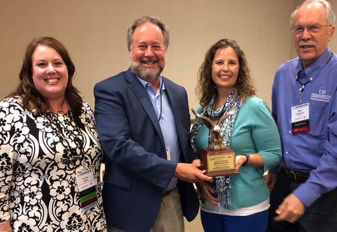 The Baxter County Forward initiative from the Mountain Home Chamber of Commerce was awarded the SOAR Award from theUniversity of Arkansas System Division of Agriculture's Community and Economic Development. Pictured are: (from left)Shelley Short,Vice President Programs and Partnerships;Jeff Pipkin, Mountain Home Area Chamber of Commerce President/CEO;Angela Broome,Mountain Home Area Chamber of Commerce Executive Vice President; and Dr. Mark Peterson,Professor ofCommunity and Economic Development with the University ofArkansas Cooperative Extension Service.