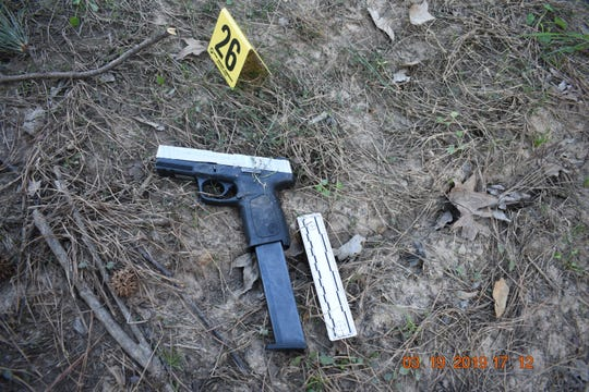An evidence packet used in grand jury proceedings for an officer-involved shooting in Bastrop features photos of the scene on March 19, 2019. Pictures include objects dropped by Thomas Johnson III, the suspect killed in the shooting, shell casings from officer's weapons and a gun Johnson held while running away from the scene of a traffic stop.