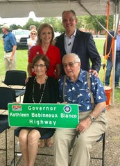 "Former Gov. Kathleen Blanco and husband Raymond ""Coach"" Blanco, seated, and Gov. John Bel Edwards and First Lady Donna Edwards celebrated the designation of the ""Governor Kathleen Baineaux Blanco Highway in Lafyette on July 2."