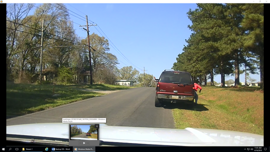 Photos in an evidence packet used in grand jury proceedings for an officer-involved shooting in Bastrop show suspect Thomas Johnson III exiting a vehicle during a traffic stop on March 19, 2019. In video footage from the same stop, Johnson starts running across an open field to the right of the SUV. In images, an object resembling a gun is visible in Johnson's hand.